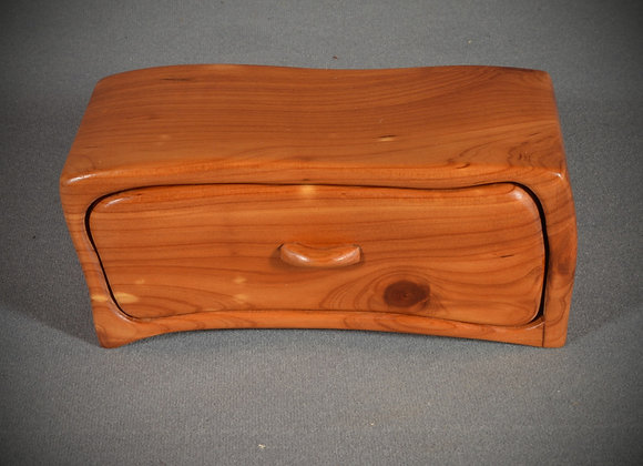 This cedar band saw box is made out of cedar.