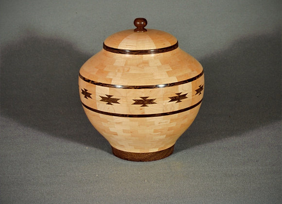 This segmented wood vessel has a southwest design.