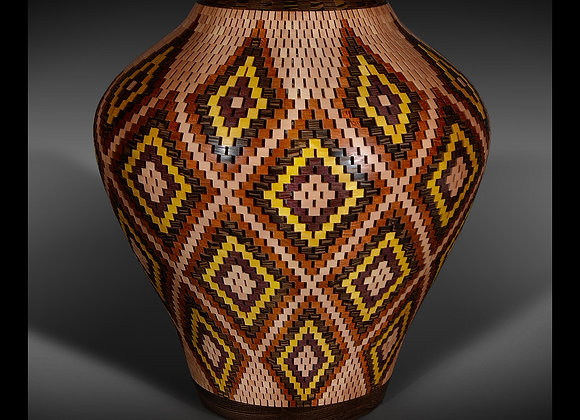 This open segmented vessel has a diamond pattern made out of different species of wood.