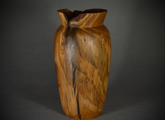 Hand turned wooden vase. This hand turned redbud vase has black epoxy filling the voids.