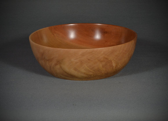 This hand turned wooden bowl is made out of pear with beautiful grain.