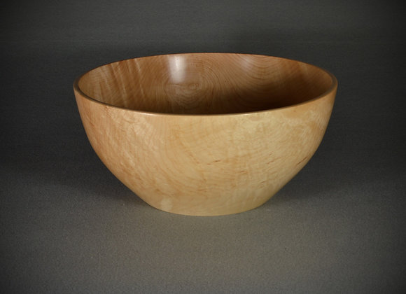 Hand turned wooden bowl. This hand turned maple bowl has a food safe finish.