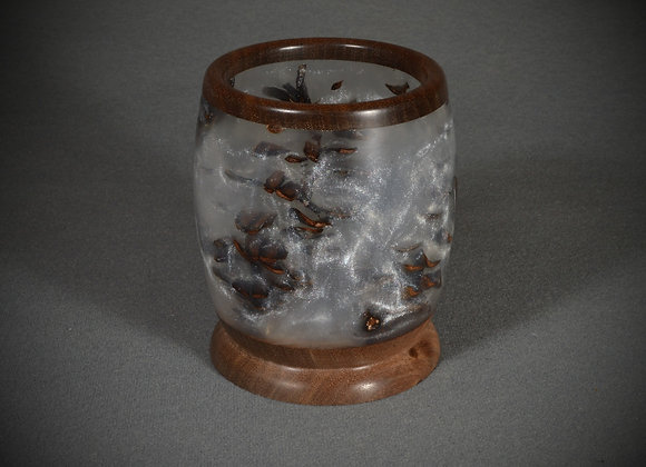 This resin and walnut vessel has pinecones in the frost colored resin.