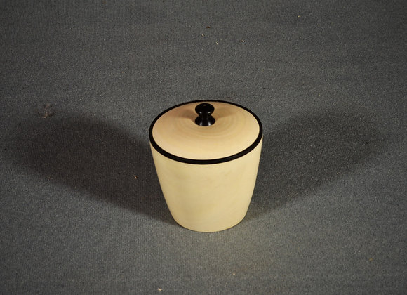 This hand turned box is made out of holly with a ebony rim and knob.