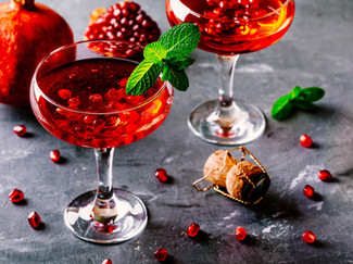 red-cocktail-with-sparkling-wine-and-pom