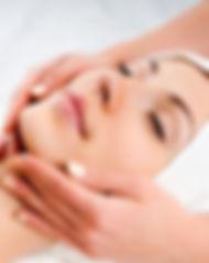 woman-receiving-facial-massage-22901655.