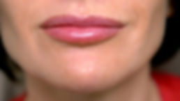 super close up. female lips with lip glo