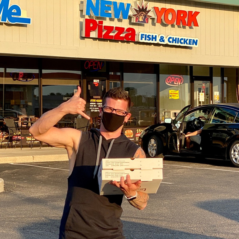 photo guy in cutoff excited about pizza