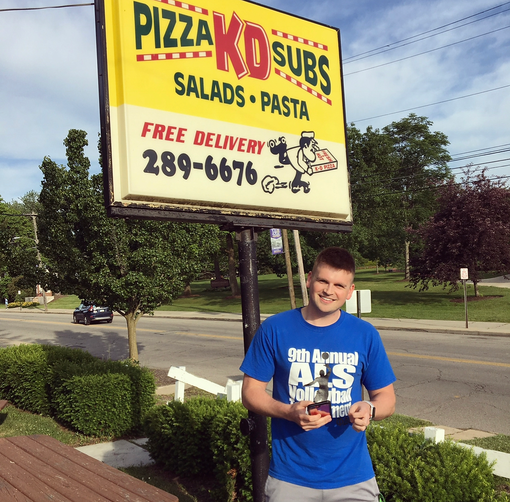 Chris by the KDs Pizza sign in Ashland Ohio