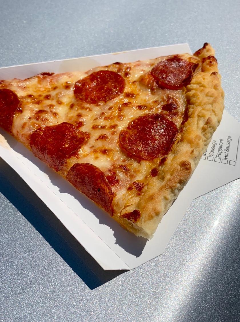 single pizza slice hood of car
