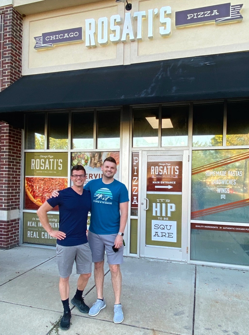 chris and eric in front of rosati's pizza in carmel