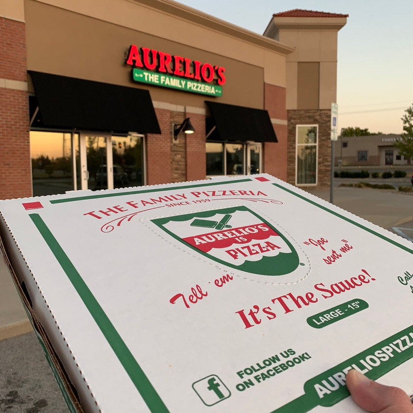 aurelios pizza box in front of store
