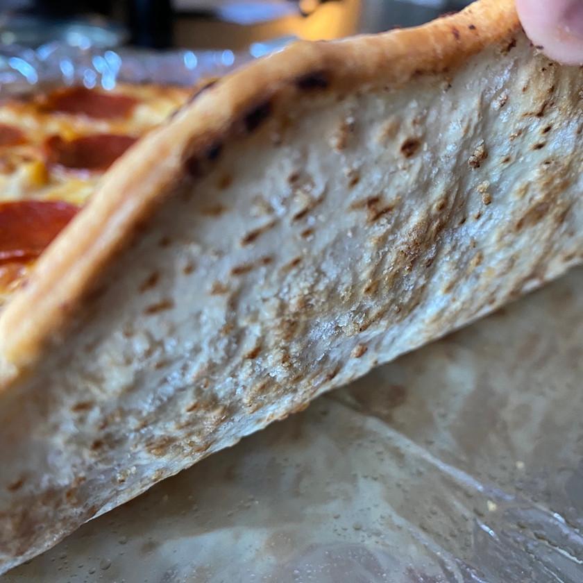 tilt shift pizza photo bottom side of crust