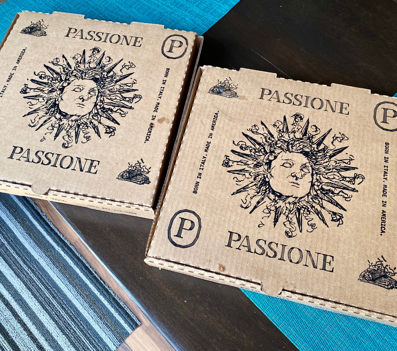 passione pizza boxes on kitchen table
