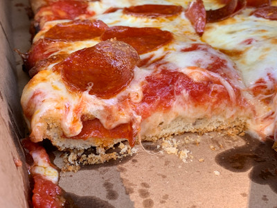 side view of sicilian style pizza slice