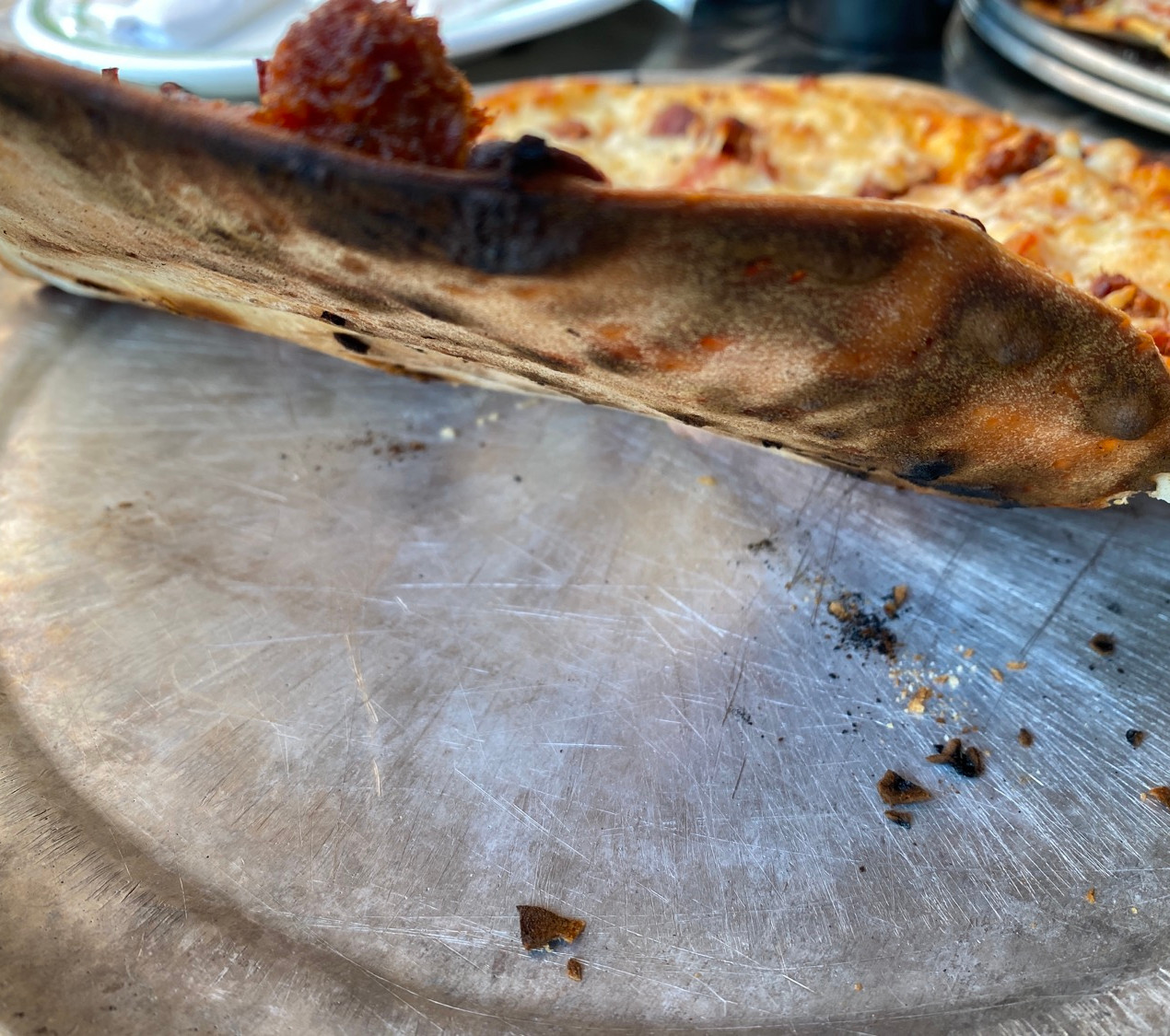 burnt edge pizza thin crust grilled