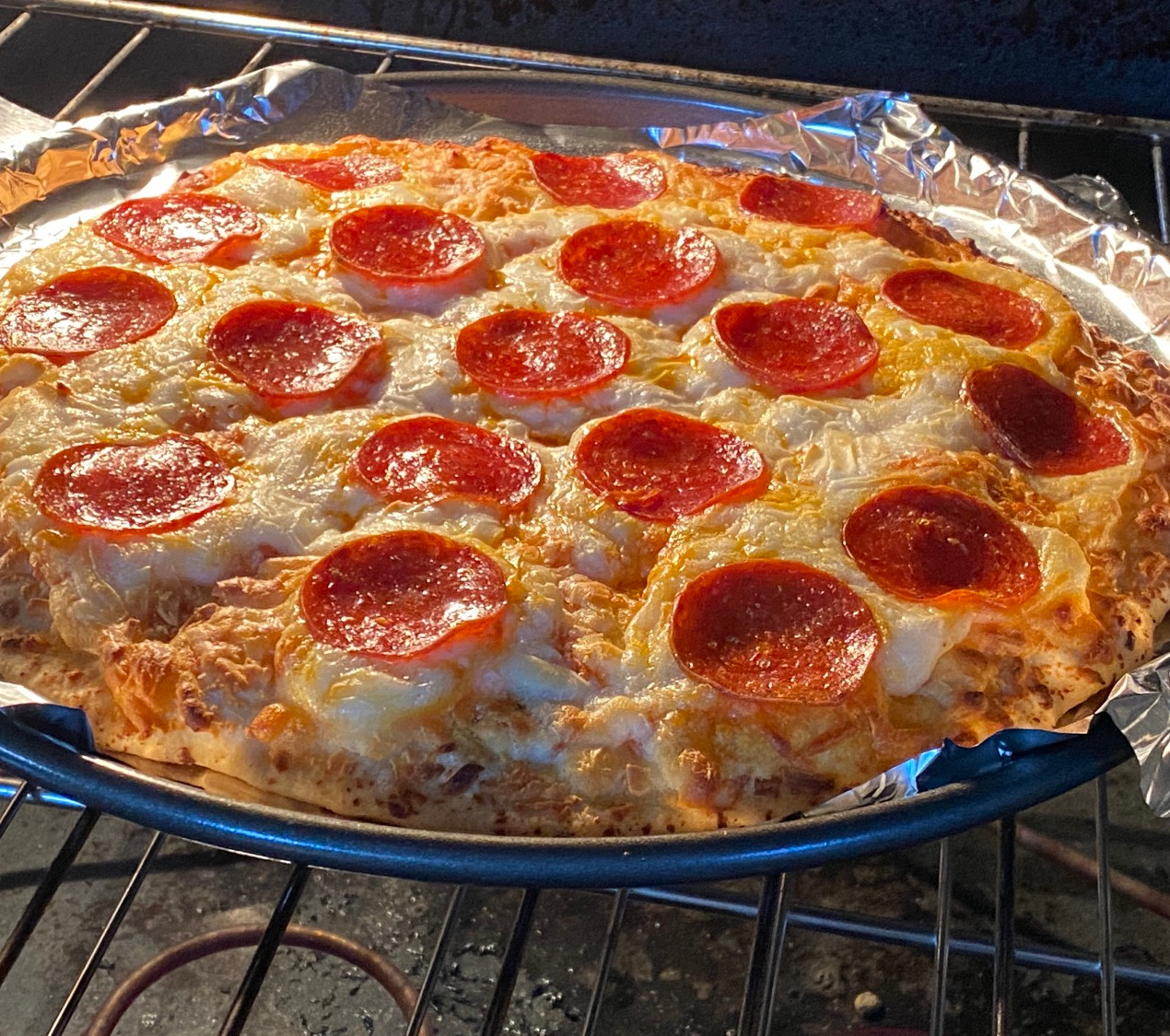 frozen pizza cooking in an oven