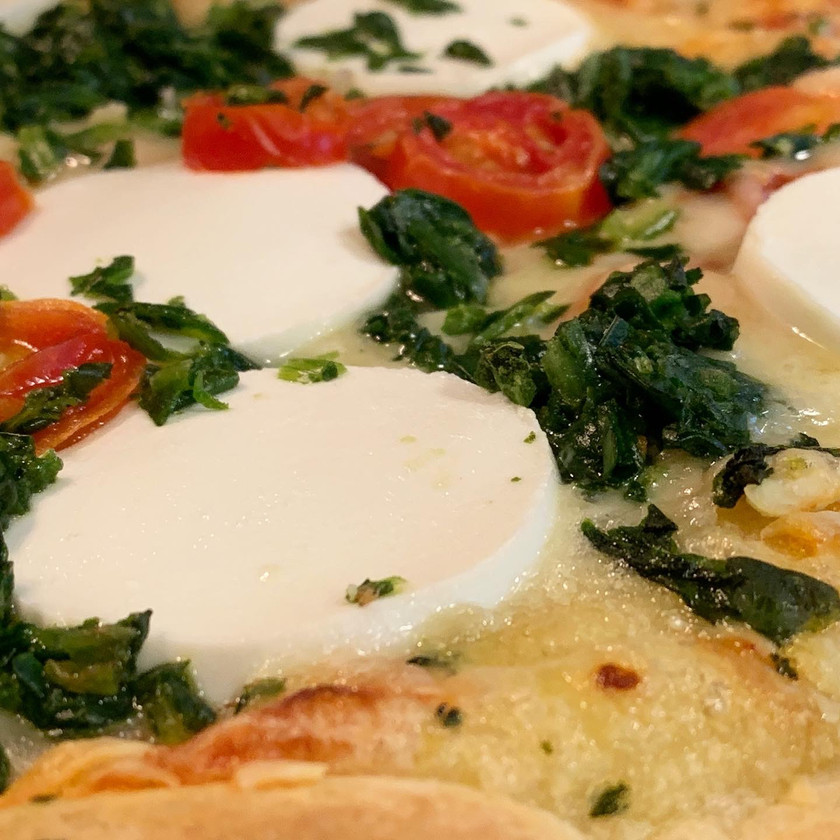 slice of goat cheese on pizza