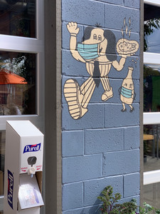 artwork and hand sanitizer at king dough