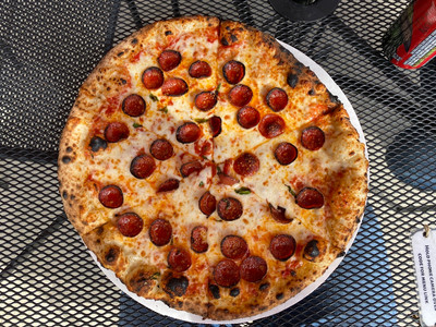 pepperoni pizza from king dough on metal patio table