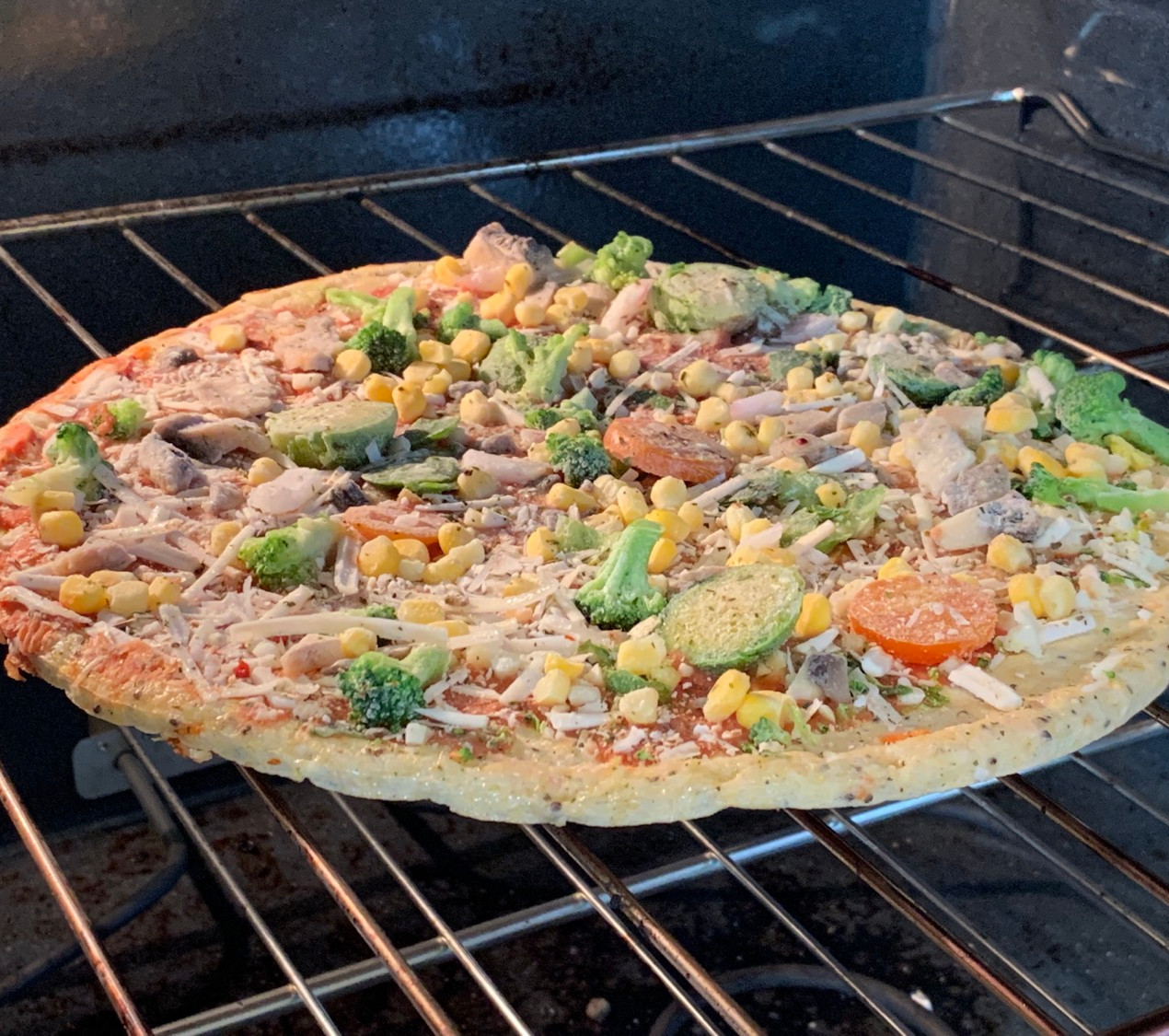 frozen veggie pizza cooking right on the oven rack