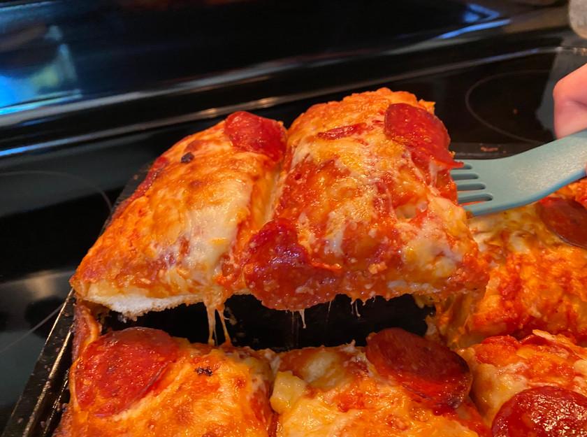 pepperoni pan pizza on spatula