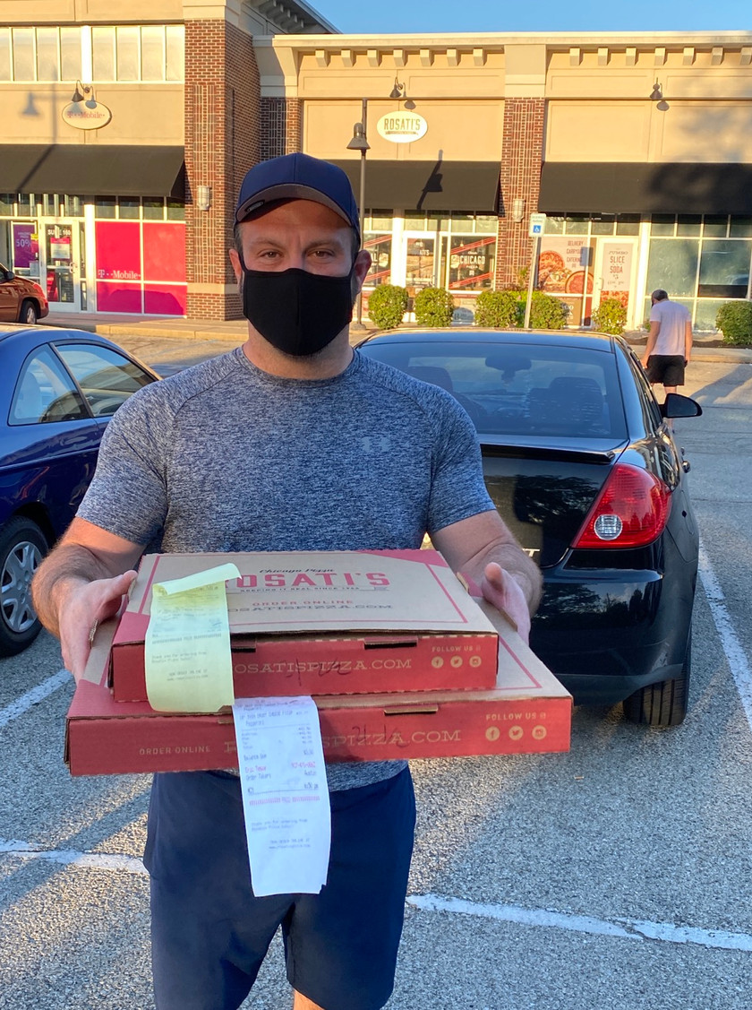 ryan carrying the big pizza boxes