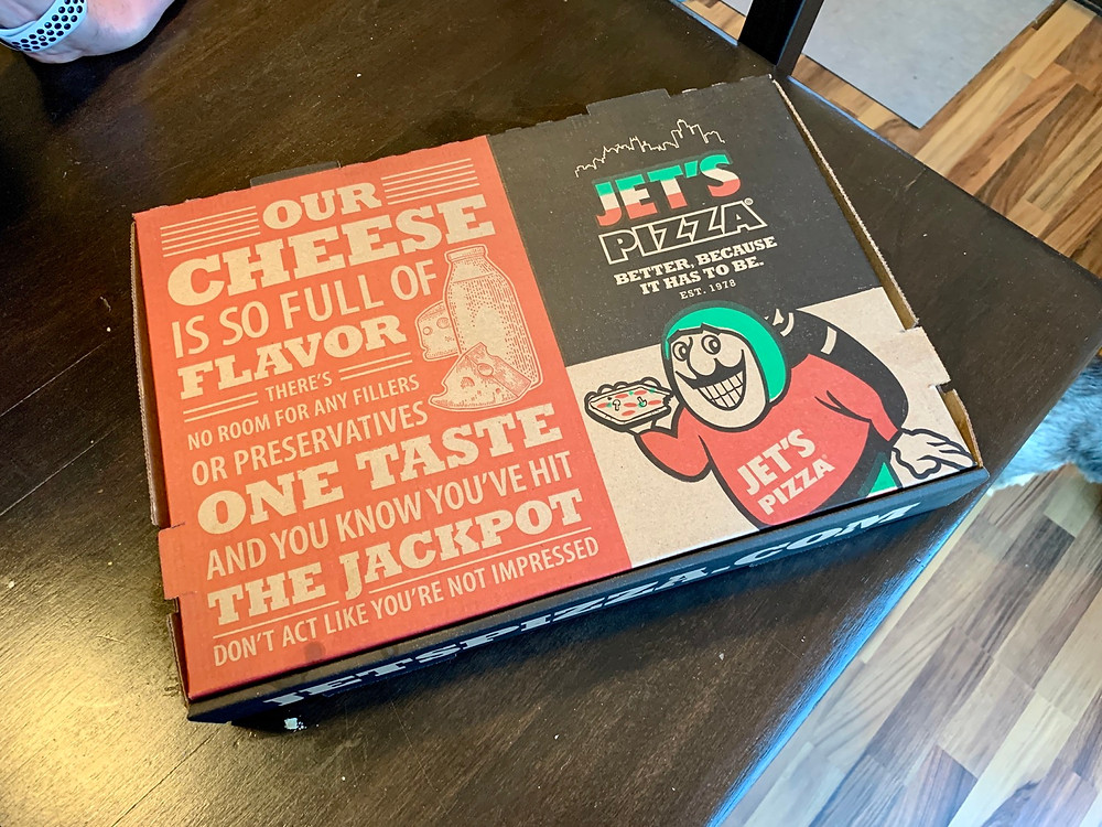 jets pizza box on a table