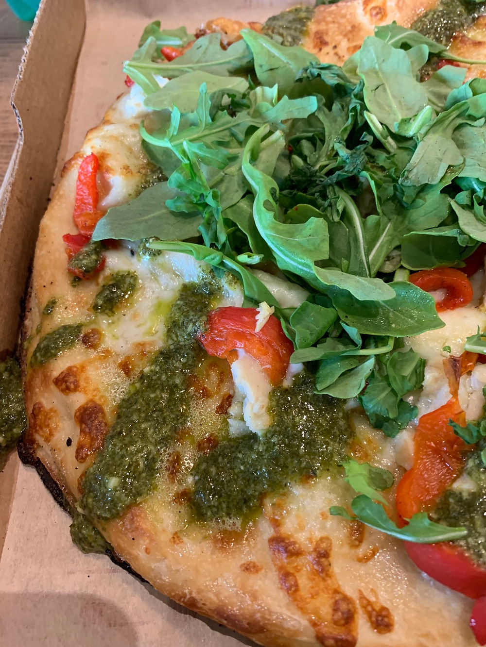 arugula peppers chicken and pesto pizza