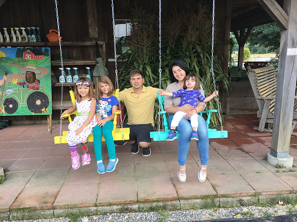 Beans & Greens Farm - farmstand family on swings.jpg