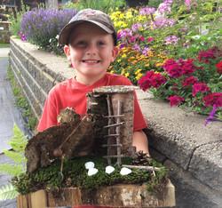 Beans & Greens Farm - fairy house and happy boy