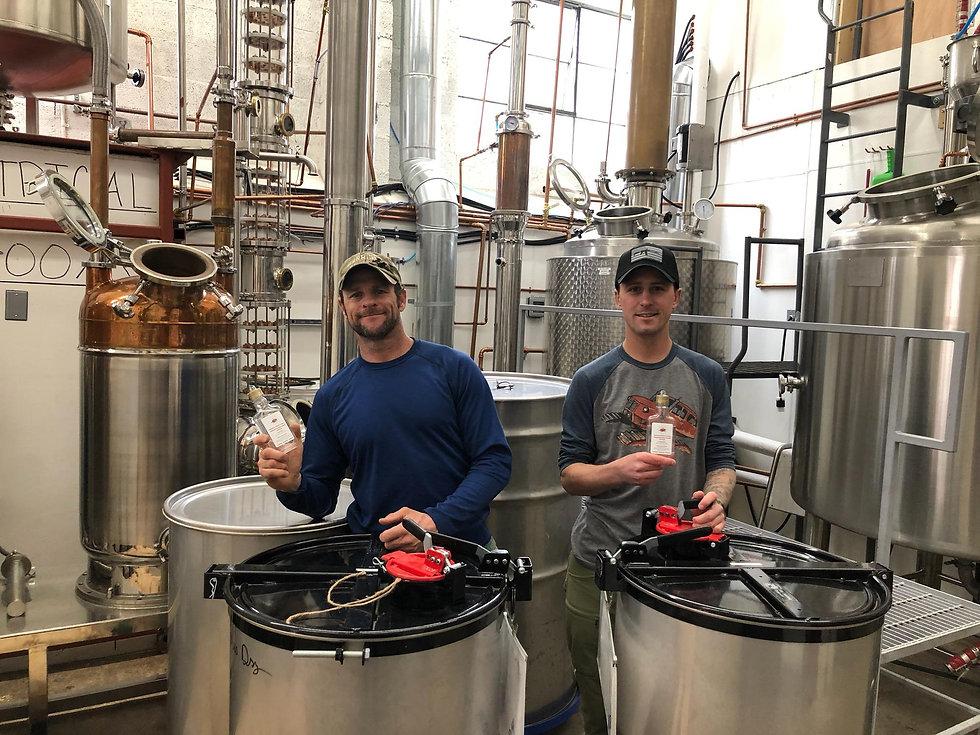 Owner Nathan Newhall & Distiller Corbin making Homegrown Hand Sanitizer