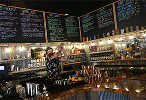 Bartender Corey Blaben mixes drinks at the bar at Steamboat Whiskey Company on Nov. 10, 2020 in Steamboat Springs.