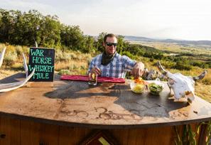 Nate serves War Horse Whiskey Mules at the steak dinner's outdoor bar