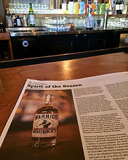 A newspaper on a table open to the 'Spirit of the Season' article