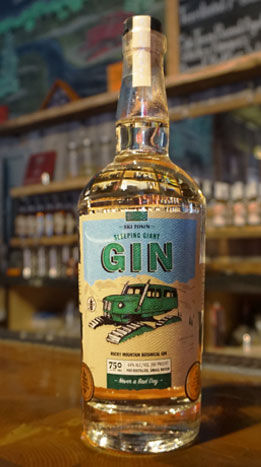 Steamboat Whiskey Company's award-winning Sleeping Giant Gin shown on a wooden bar top