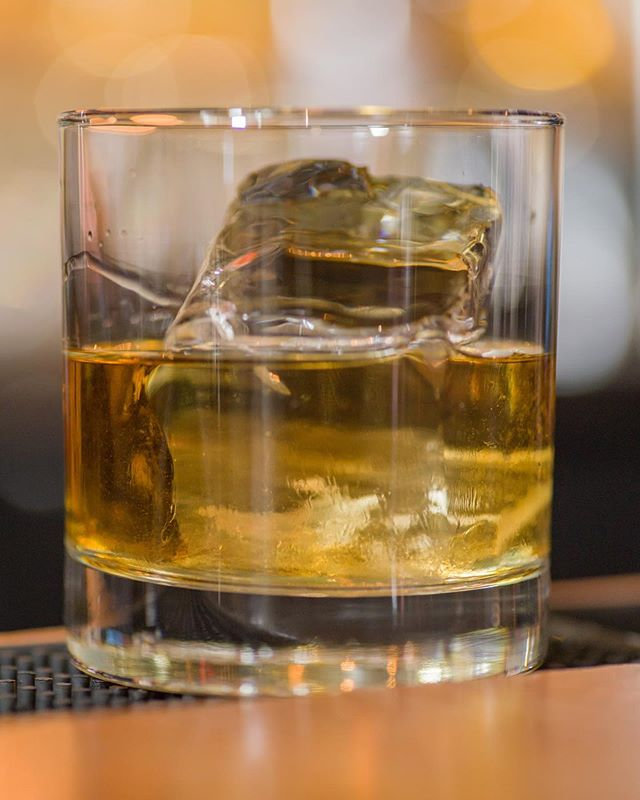 Close-up view of a glass containing whiskey and ice