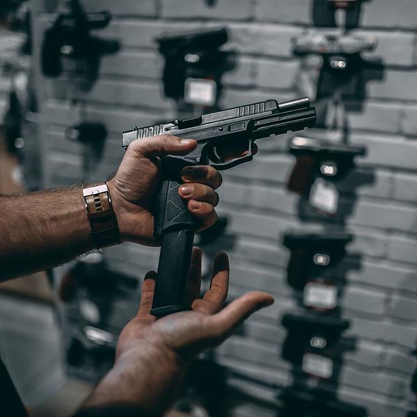 man-choosing-new-handgun-in-gun-shop-XD6