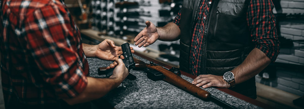 man-with-owner-choosing-handgun-in-gun-s