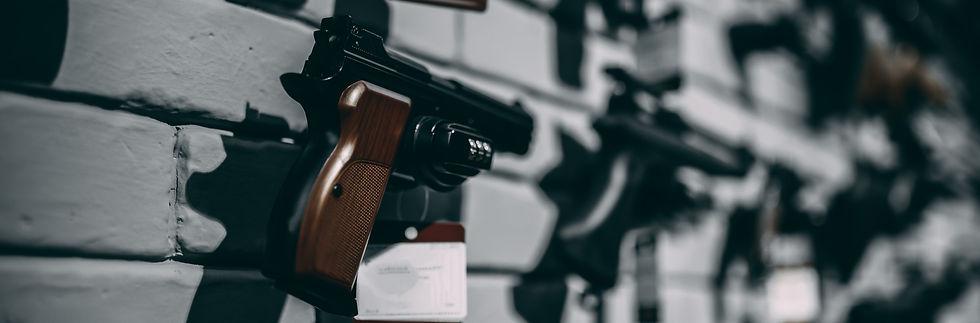 handguns-on-showcase-in-gun-shop-closeup