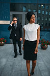 business-woman-bodyguard-in-suit-on-back