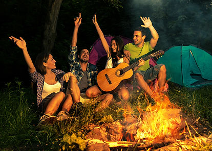 Group of friends camping.They are sittin