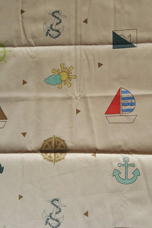 Tela 100% algodón 40 x 50 cm en color beige con dibujos marineros