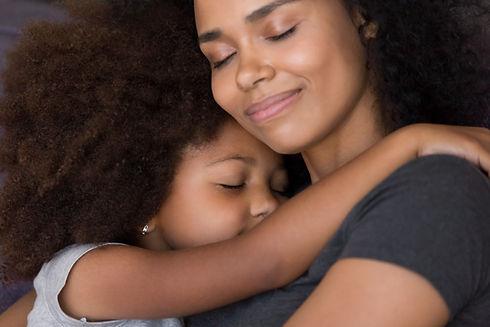 Loving single black mother hugs cute daughter feel tenderness connection, happy african mu