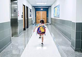 Child running through corridor.