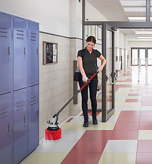 MotorScrubber JET3 with red stairbrush cleaning corridor edges in a school