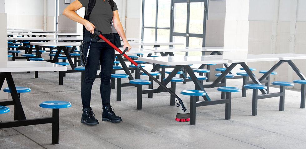 MotorScrubber JET3 scrubbing floor in school cafeteria