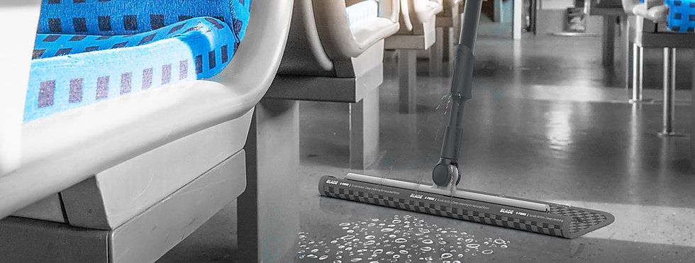 BLADE cleaning the aisle on a train.