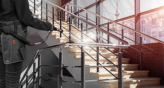STORM-spraying-handrail-in-school.jpg