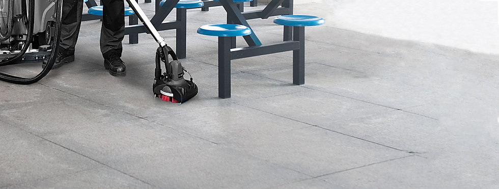 MotorScrubber FORCe attache dto a large scrubber dryer cleaning underneath seating in a canteen.